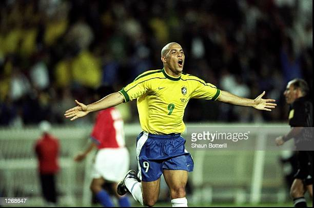 Ronaldo of Brazil celebrates scoring in the World Cup second round match against Chile at the Parc des Princes in Paris Ronaldo scored twice as...