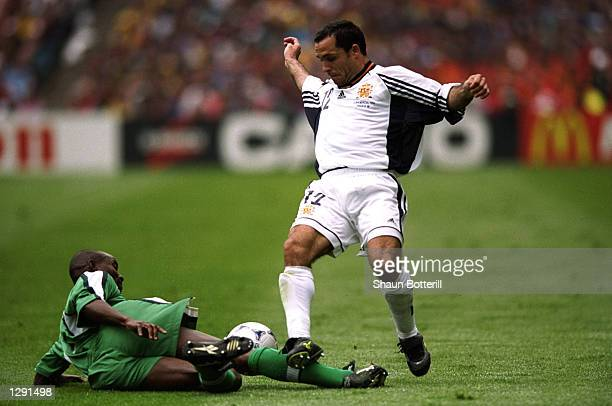 Sergi Barjuan of Spain is tackled during the World Cup group D game against Nigeria at the Stade de la Beaujoire in Nantes France Spain lost 32...