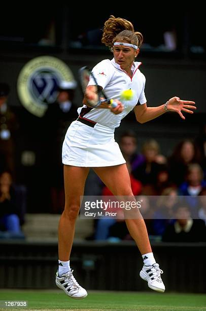 Steffi Graf of Germany plays a forehand during Day 5 of the 1998 Wimbledon Championships played in Wimbledon London England Mandatory Credit Gary M...