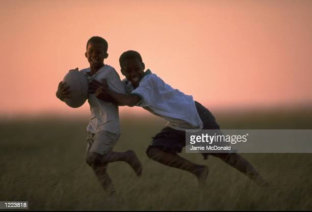 African children playing rugby in East London South Africa Mandatory Credit Jamie McDonald /Allsport
