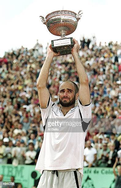 Andre Agassi of the USA lifts the trophy high above his head after defeating Andrei Medvedev of the Ukraine to win the men's singles final of the...