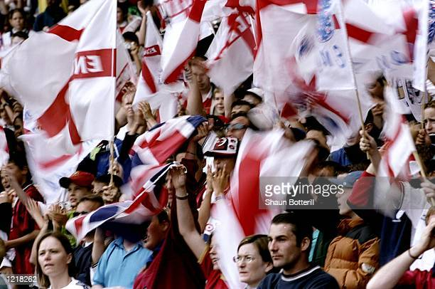 England fans show their support for the team during the European Championships Qualifier match against Sweden played at Wembley Stadium in London...