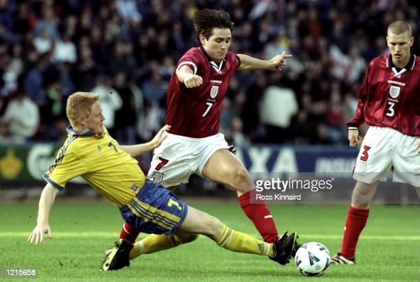 Frank Lampard of England takes on Marcus Vaapil of Sweden in the European Under21 Championship qualifier at the Alfred McAlpine Stadium in...