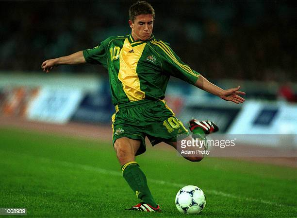 Harry Kewell no 10 of Australia crosses to the middle during Australia v FIFA World Stars game at Stadium Australia Homebush Sydney Australia As the...