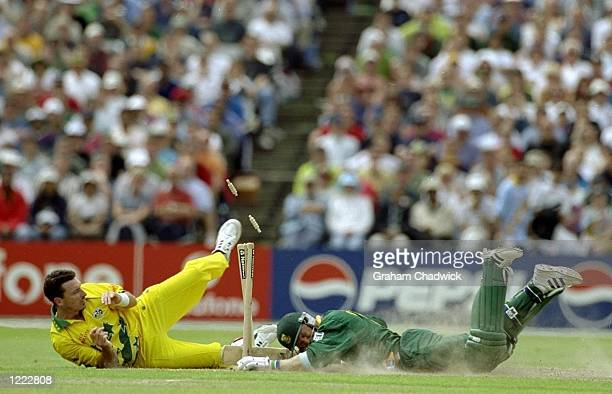Jonty Rhodes of South Africa dives headlong into the stumps as Damien Fleming of Australia attempts to run him out in the World Cup Super Six match...