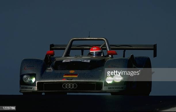 Pirro Biela and Theys drivers of the Audi R8R team car in action during the Le Mans 24 Hour Race held at the Circuit De La Sarthe in France The Audi...