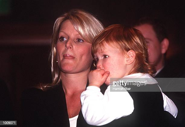 Simone Warne Shane Warne's wife holds daughter Brooke during a State Reception held by the Victorian Government in celebration of the Australian...