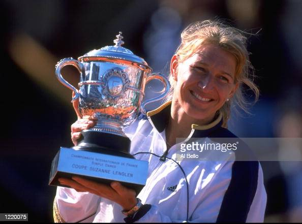 Steffi Graf of Germany celebrates victory with the trophy after the 1999 French Open Final match against Martina Hingis of Switzerland played at...