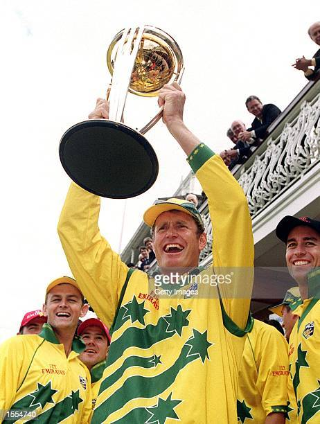 Tom Moody of Australia celebrates on the balcony with the World Cup trophy after Australia's win in the World Cup Final match between Australia and...