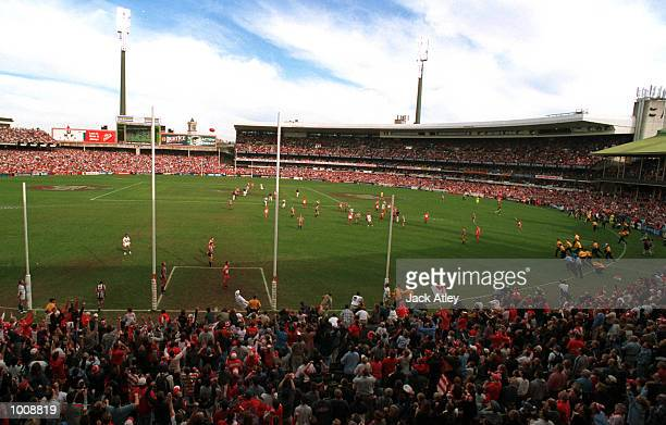 Tony Lockett of Sydney Swans kicks his 1300th goal to break Gordon Coventry's previous record of 1299 during the match between Sydney Swans v...