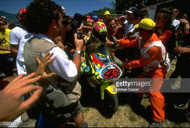 Valentino Rossi who rides an Aprilia250 bike is mobbed by fans during the FIM Italian Motorcycle Grand Prix held at the Mugello circuit in Tuscany...