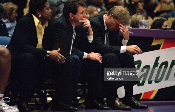 Assistant Coach Alisa Scott Head Coach Van Chancellor and Assistant coach Kevin Cook of the Houston Comets watch the action during the game against...