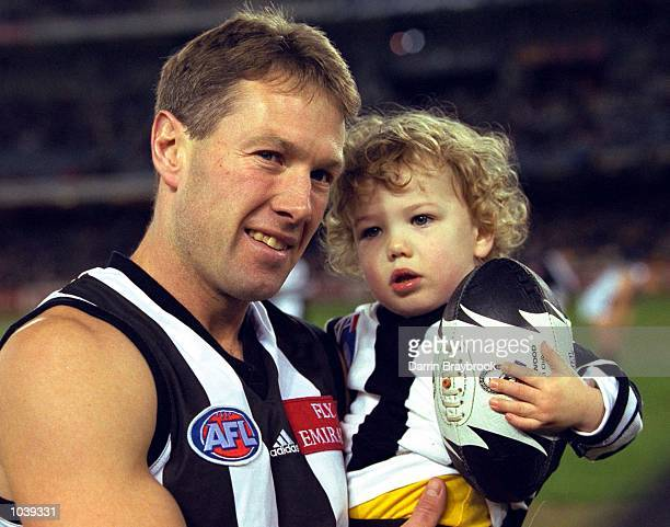 Gavin Brown for Collingwood with his child Calum before his 250th game in the round 16 match between the Collingwood Magpies and the Hawthorn Hawks...