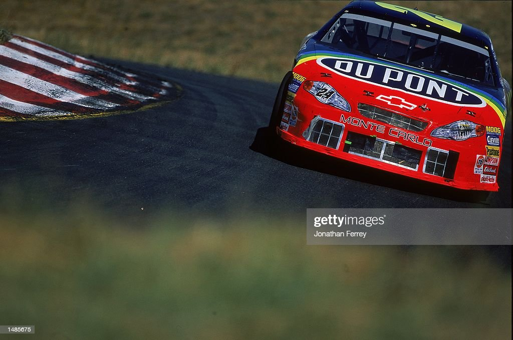 Jeff Gordon who drives a Chevrolet Monte Carlo for Hendricks Motorsports comes around a corner during the SaveMart/Kragen 350 presented by NAPA part...