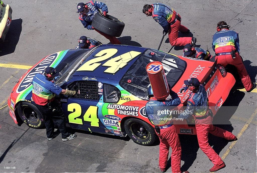 Jeff Gordon who drives for Hendrick Motorsports makes a pit stop during the Save Mart/Kragen 350 part of the 2000 NASCAR Winston Cup Series at the...