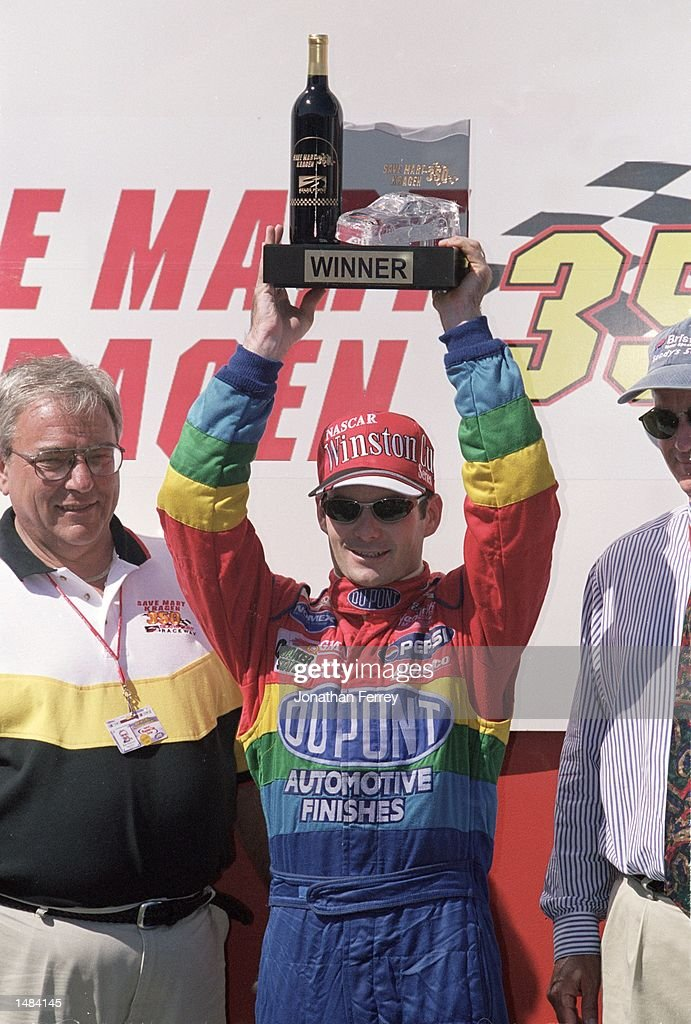 Jeff Gordon who drives for Hendrick Motorsports raises his trophy after winning the Save Mart/Kragen 350 part of the 2000 NASCAR Winston Cup Series...