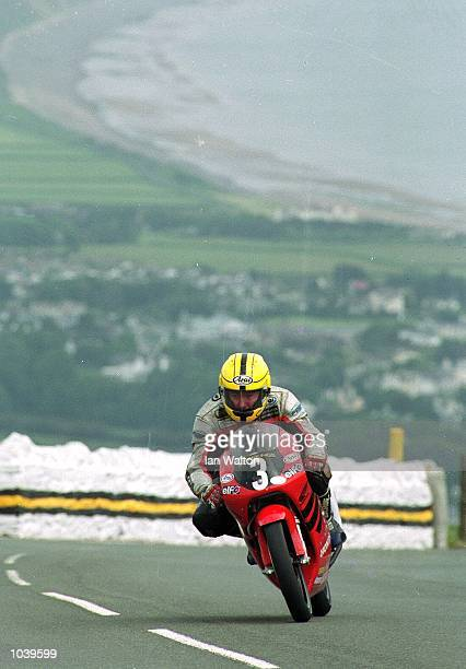 Joey Dunlop at Guthries on his way to victory in the UltraLightweight class during the Isle of Man TT Races on the Isle of Man Great Britain...