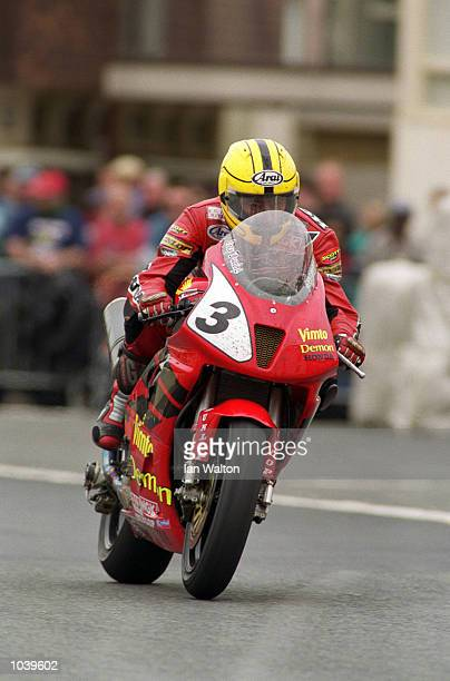 Joey Dunlop at Parliament Square on his way to victory in the Formula One TT class during the Isle of Man TT Races on the Isle of Man Great Britain...
