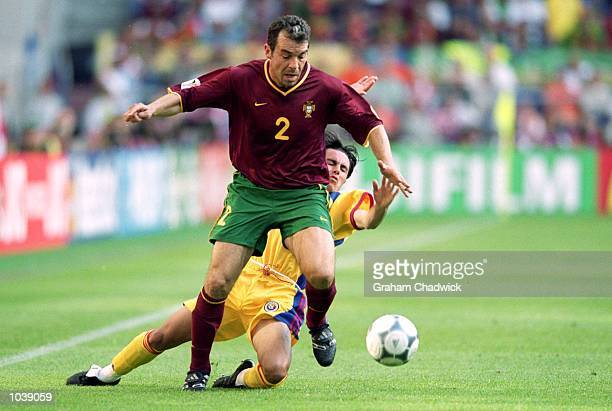 Jorge Costa of Portugal beats Florentin Petre of Romania to the ball during the European Championships 2000 Group Stage at the Gelredome Arnhem...