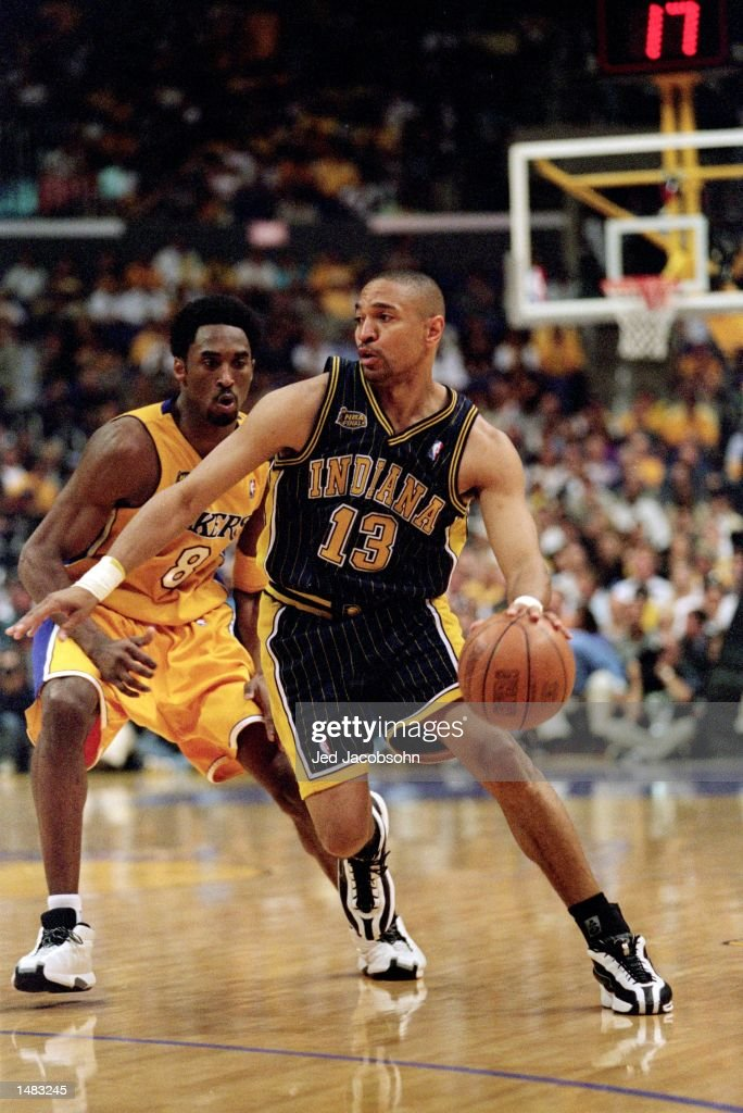 Mark Jackson of the Indiana Pacers dribbles the ball down the court as he is guarded by Kobe Bryant of the Los Angeles Lakers during the NBA Finals...