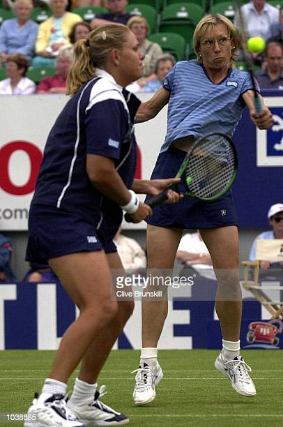 Martina Navaratilova of the USA in action in her doubles match with Mariaan de Swardt of South Africa against Nathalie Tauziat of France and Ai...