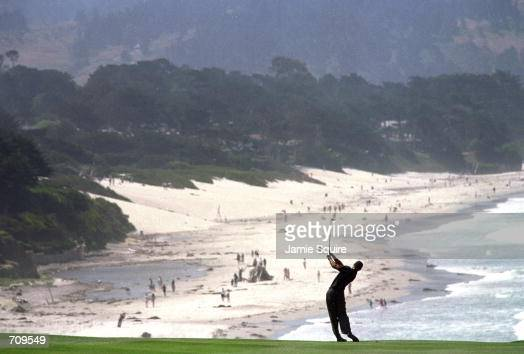 Tiger Woods takes a swing during the 100th US Open at the Pebble Beach Golf Club in Pebble Beach CaliforniaMandatory Credit Jamie Squire /Allsport