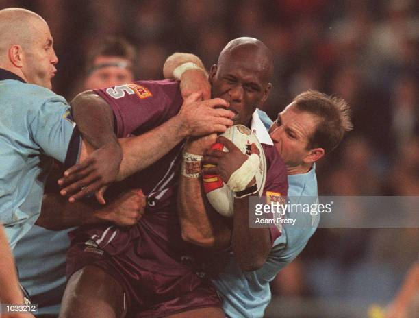 Wendell Sailor of Queensland is tackeled by Tim Brasher and Adam McDougall of NSW during the State of Origin clash between NSW and Queensland at...