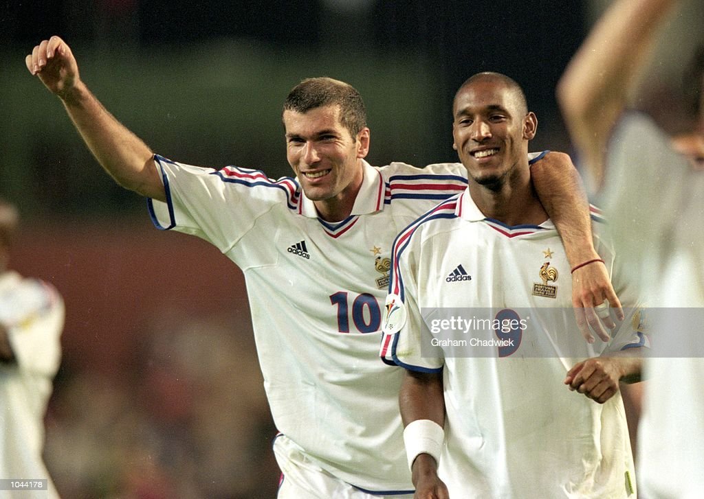 Zinedine Zidane (10) and Nicolas Anelka (9) of France celebrate after the European Championships 2000 semi-final against Portugal at the King Baudouin Stadium in Brussels, Belgium. France won the match 2-1 with a golden goal in extra-time.\ Mandatory Credit: Graham Chadwick /Allsport