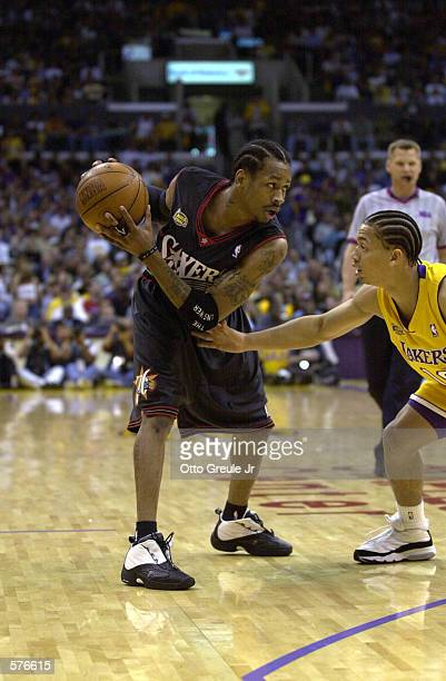 Allen Iverson of the Philadelphia 76ers is defended by Tyronn Lue of the Los Angeles Lakers in game two of the NBA Finals at Staples Center in Los...