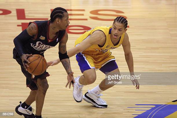 Allen Iverson of the Philadelphia 76ers is defended by Tyronn Lue of the Los Angeles Lakers in game one of the NBA Finals at Staples Center in Los...