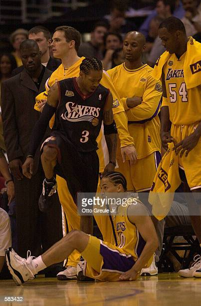 Allen Iverson of the Philadelphia 76ers steps over Tyrone Lue of the Los Angeles Lakers in Game 1 of the NBA Finals at Staples Center in Los Angeles...