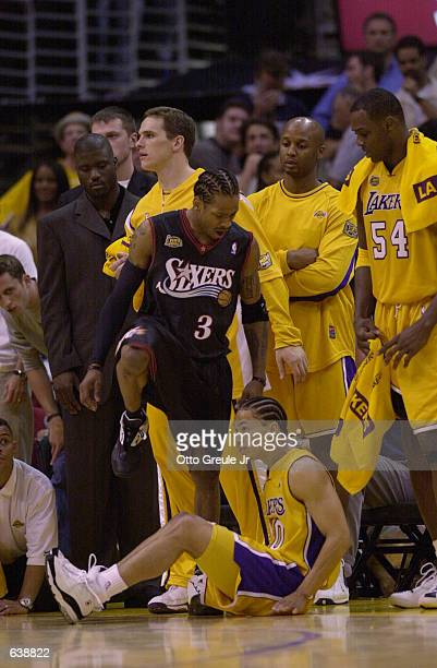 Allen Iverson of the Philadelphia 76ers steps over Tyronn Lue of the Los Angeles Lakers in game one of the NBA Finals at Staples Center in Los...