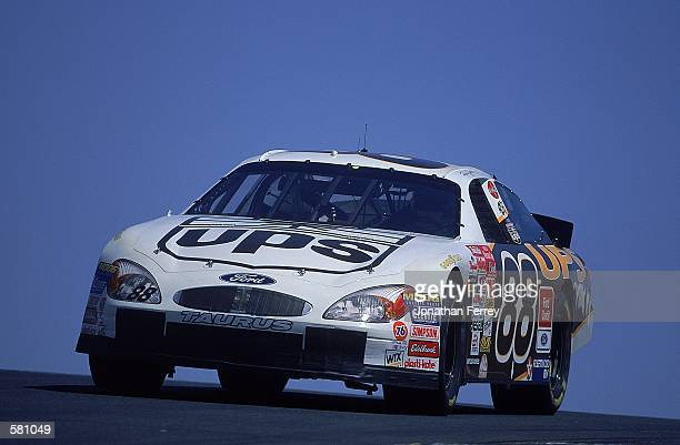 Dale Jarrett who drives the Ford Taurus for Robert Yates Racing comes down the track during the Dodge/Savemart 350 part of the NASCAR Winston Cup...