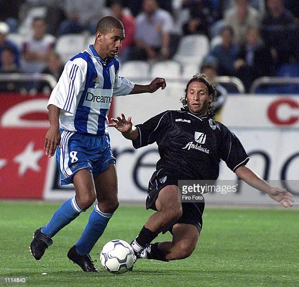 Djalminha of Deportivo and Rufete and Bravo of Malaga in action during the Primera Liga match played between Deportivo La Coruna and Malaga played at...