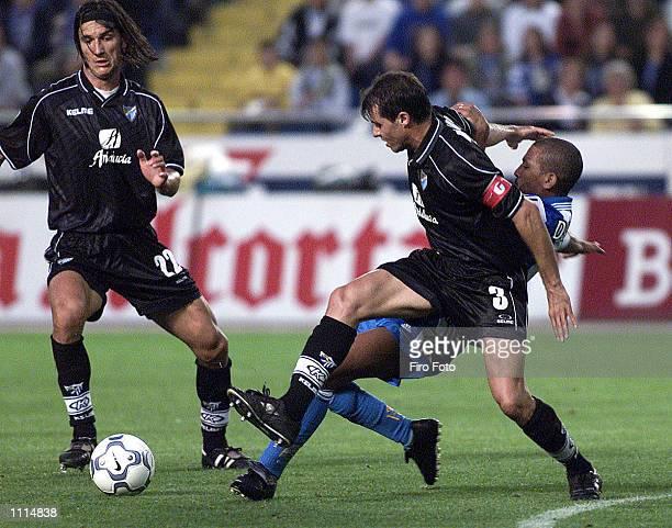 Djalminha of Deportivo La Coruna and De Los Santos and Bravo of Malaga in action during the Primera Liga match played between Deportivo La Coruna and...