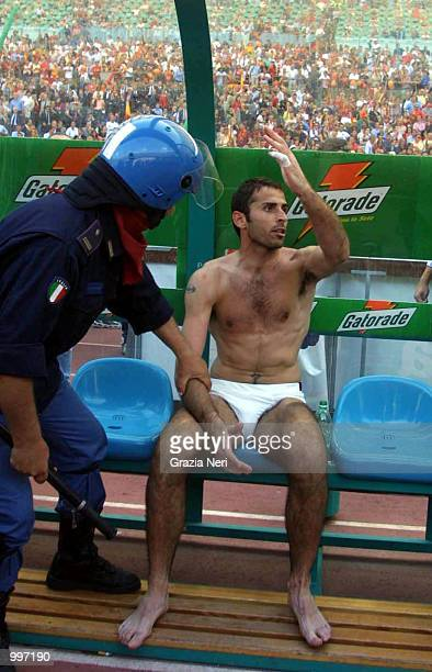 Francesco Antonioli sits on the bench without his kit after Roma fans invade the pitch and steal them from him minutes before the end of the Serie A...