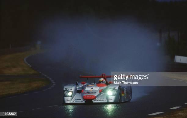 Frank Biela Emanuele Pirro and Tom Kristensen drive the Team Audi Joest car during the Le Mans 24 Hour Race at Circuit de la Sarthe in Le Mans France...
