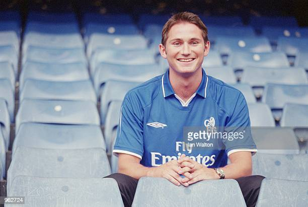 Frank Lampard of Chelsea poses for the cameras in his new surroundings during the press conference to announce his transfer to Chelsea held at...