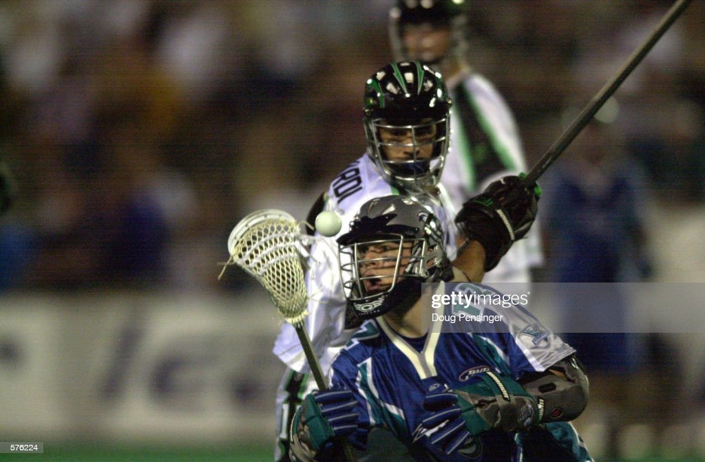 Greg McCavera of the Baltimore Bayhawks tries to collect the ball after having it knocked away by John Gagliardi of the Long Island Lizards during a...