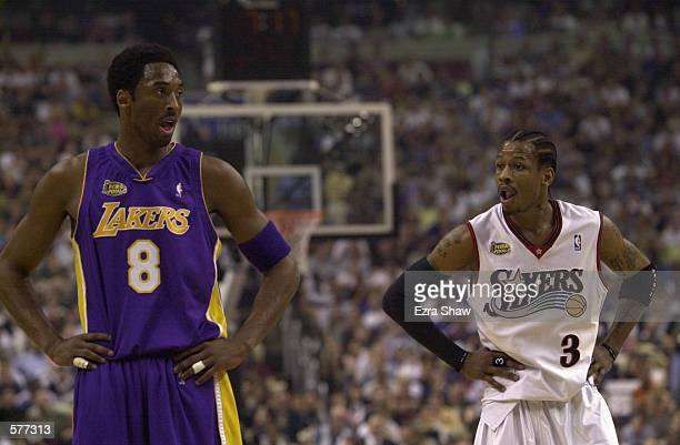Kobe Bryant of the Los Angeles Lakers stands with Allen Iverson of the Philadelphia 76ers in game three of the NBA Finals at the First Union Center...