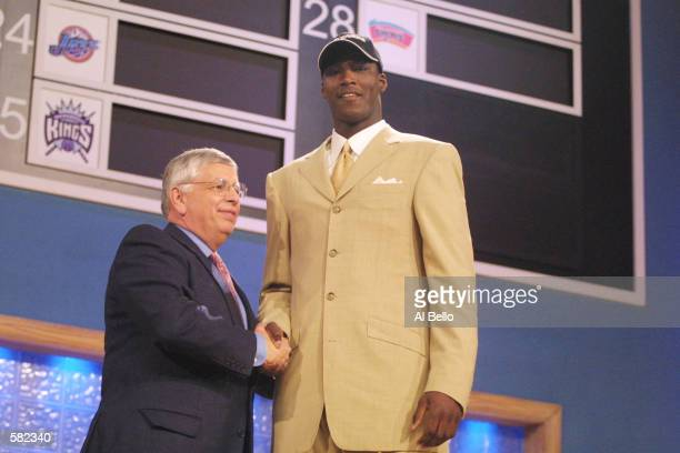 NBA Commissioner David Stern congratulates Kwame Brown of Glynn Acadamy in Brunswick Georgia after being the first pick in the NBA Draft by the...