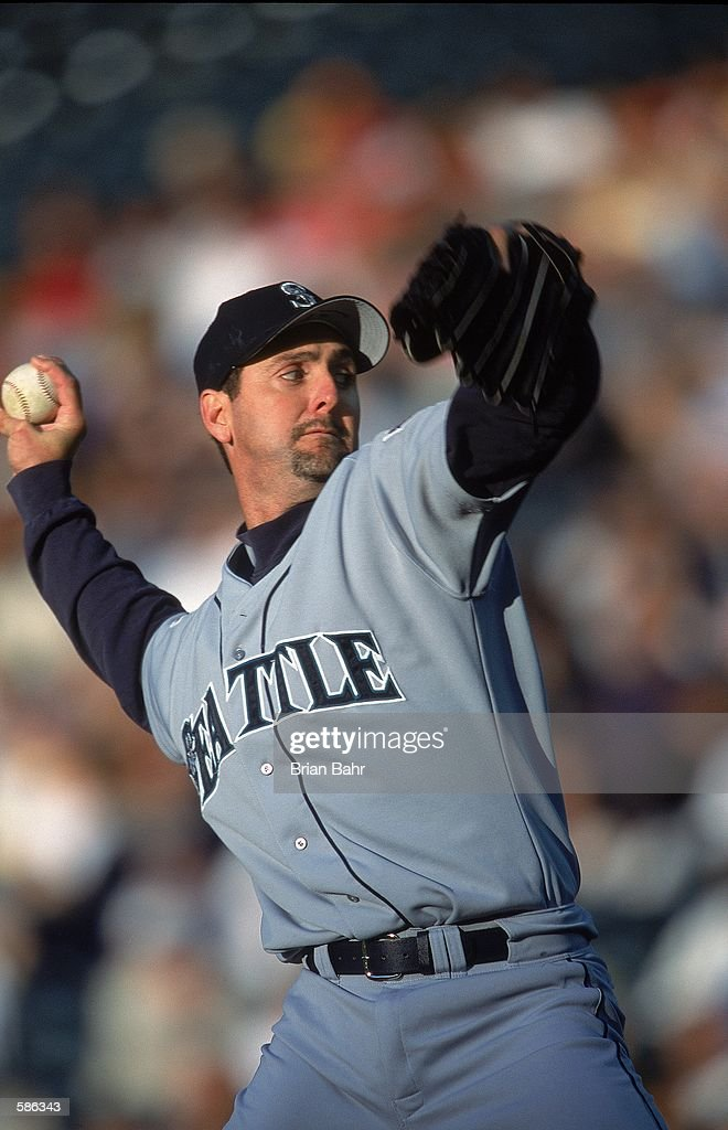 Paul Abbott of the Seattle Mariners pitches during the game against the Colorado Rockies at Coors Field in Denver Colorado The Rockies defeated the...
