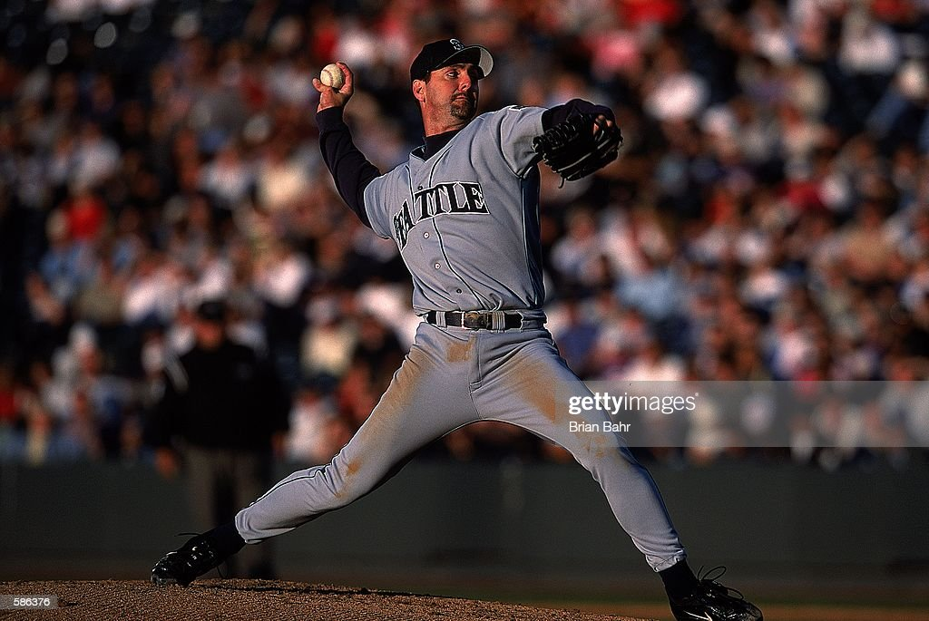 Paul Abbott of the Seattle Mariners throws the ball during the game against the Colorado Rockies at Coors Field in Denver Colorado The Rockies...