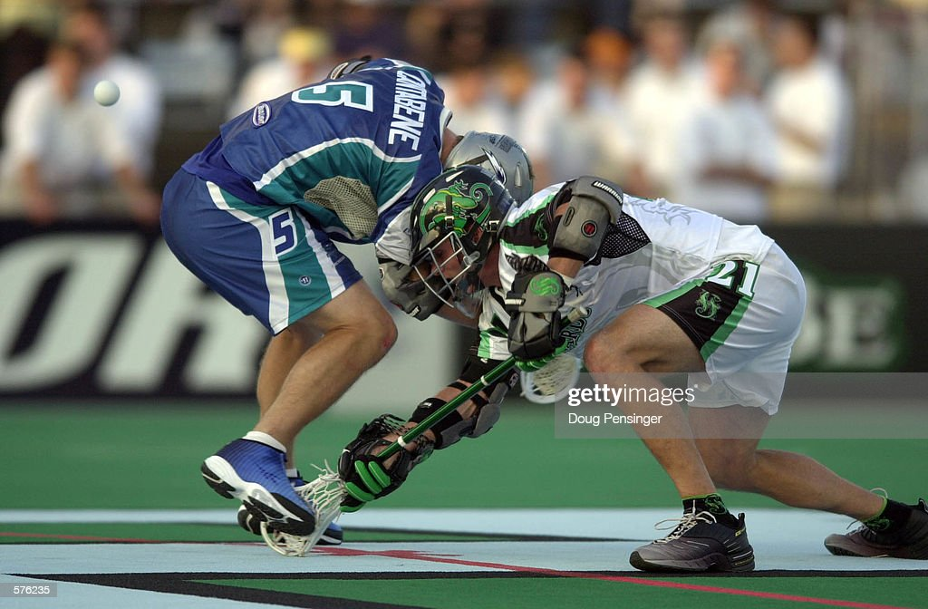 Paul Cantabene of the Baltimore Bayhawks faces off against Tim Byrnes of the Long Island Lizards during a Major League Lacrosse game on Homewood...