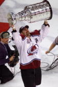 Ray Bourque of the Colorado Avalanche skates away with the Stanley Cup after 22 seasons in pursuit of the NHL Stanley Cup Championship Denver...
