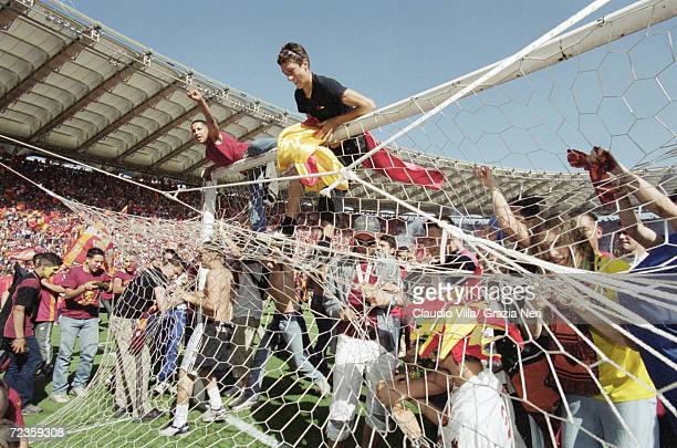 Roma fans celebrate the Scudetto by invading the pitch after a 31 victory in the Serie A match against Parma at the Stadio Olimpico in Rome Mandatory...