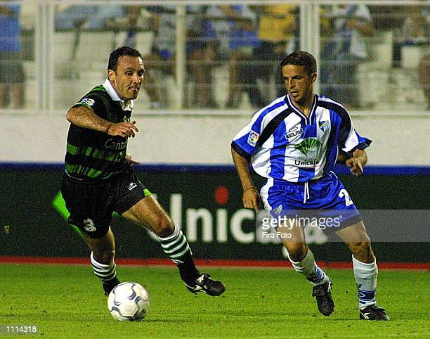 Sandro of Malaga and Espina of Racing Santander in action during the Primera Liga match played between Malaga and Racing Santander at La Rosaleda...