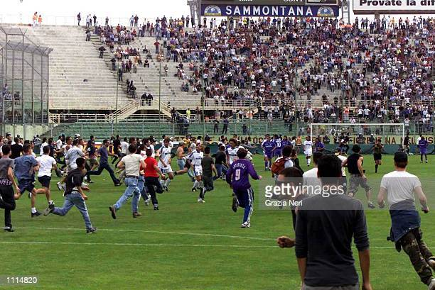 Supporters of Fiorentina invade the pitch during the Serie A 34th Round League match between Fiorentina and Napoli played at the Artemio Franchi...