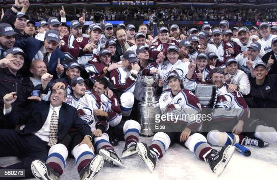 The Colorado Avalanche pose with the Stanley Cup after they defeated the New Jersey Devils 31 in game seven of the NHL Stanley Cup Finals at Pepsi...