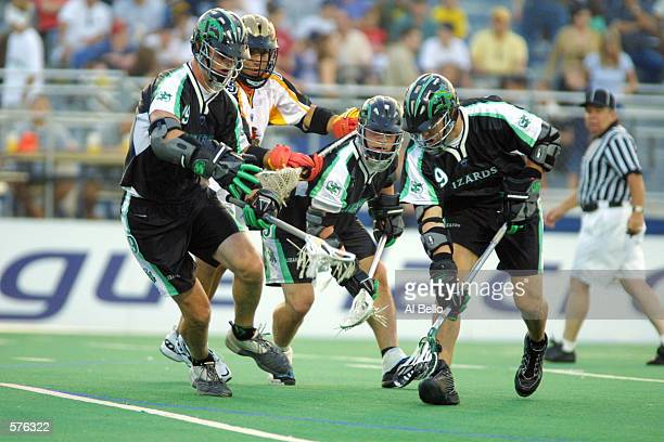 Tim Goettelman of the Long Island Lizards fights for the ball with his teammates against the Rochester Rattlers during their Major League Lacrosse...